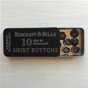 Shirt buttons in a tin