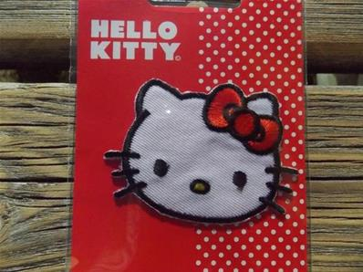 Motif thermocollant Hello Kitty avec noeud rouge